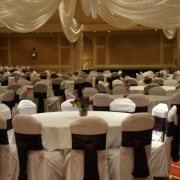 mankato wedding chair covers, southern minnesota wedding chair covers, chair cover bands, ruched chair covers, modern chair covers, pleated chair covers, wedding table linens, wedding decor, wedding reception, hotel chair covers